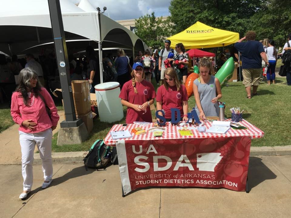 Student Dietetics Association members standing at their booth during Carnival of Clubs.